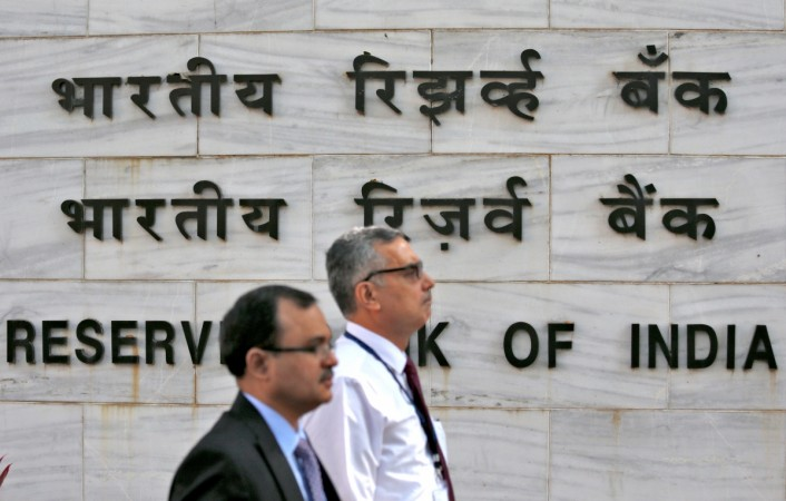 People walk past the Reserve Bank of India head office in Mumbai India