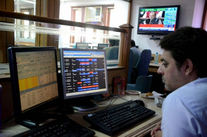 A stock broker looks at a television screen in Mumbai as Finance Minister Arun Jaitley presents India's first unified