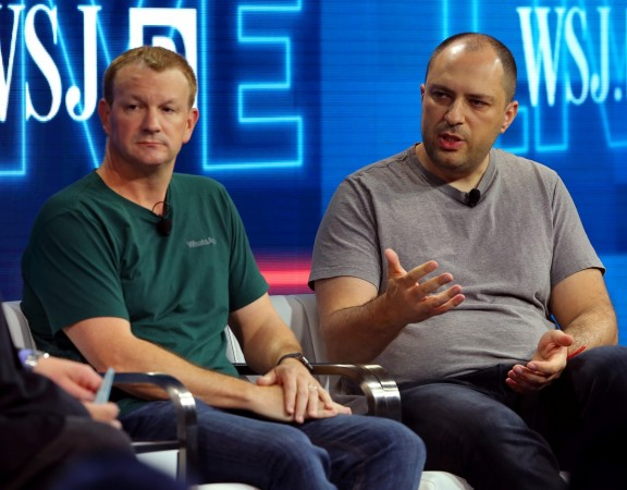 Brian Acton, co-founder of WhatsApp (L) and Jan Koum, co-founder and CEO of WhatsApp
