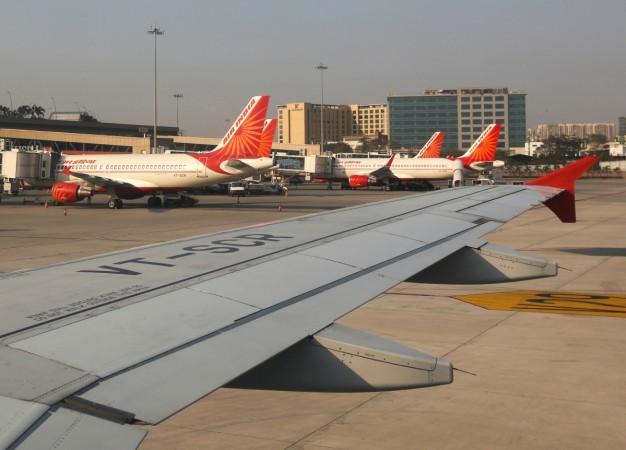Air India passenger planes are seen parked at the Chhatrapati Shivaji International airport in Mumbai India