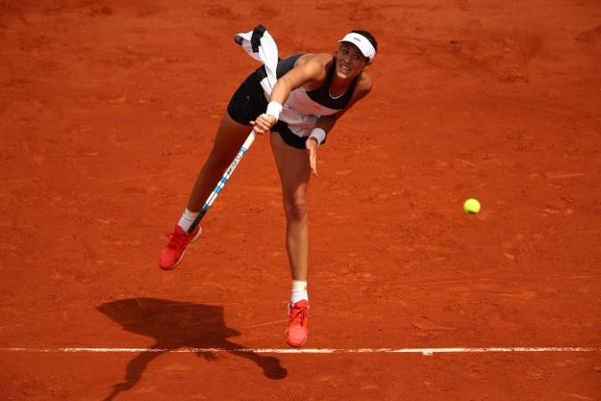 Defending champion Muguruza crashes out of French Open