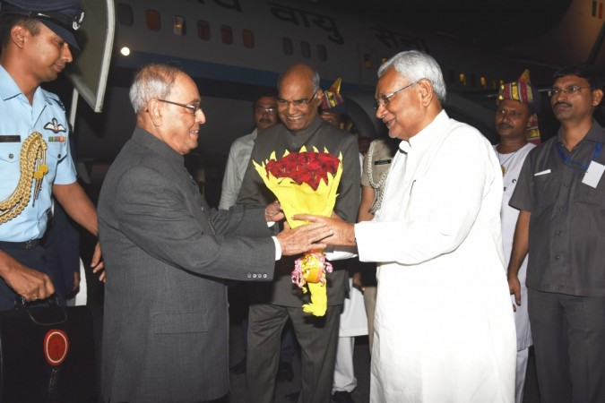 President Pranab Mukherjee being welcomed by Bihar Governor Ram Nath Kovind and Chief Minister Nitish Kumar at Jaiprakash Narayan International airport in Patna on Aug 26, 2016. (Photo: IANS)