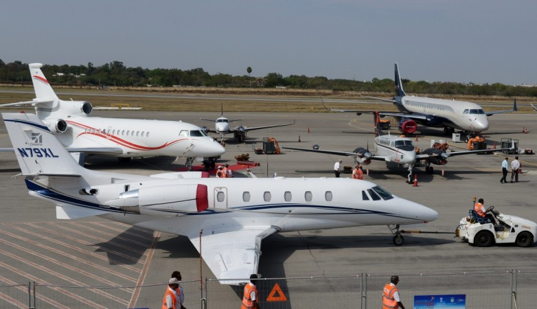 gmr group, hyderabad airport, gmr to sell stake to abu dhabi investment authority, gmr stake sale hyderabad airport