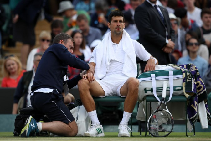 Djokovic to miss rest of the season with right elbow injury