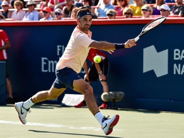 Federer struggles before beating Tiafoe in five sets at US Open