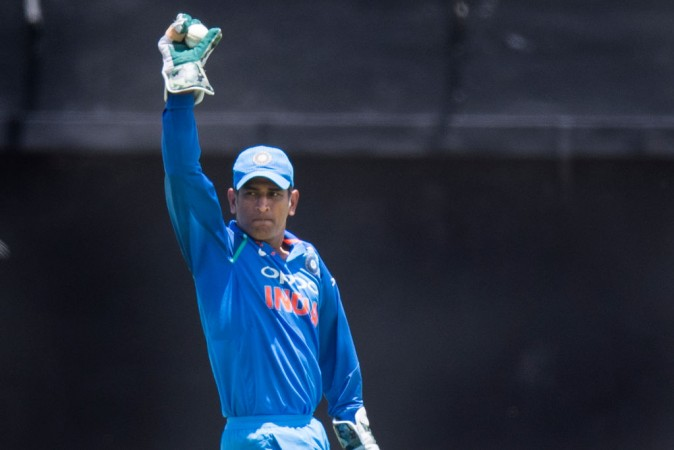 MS Dhoni shows what he can do with a gun in hand