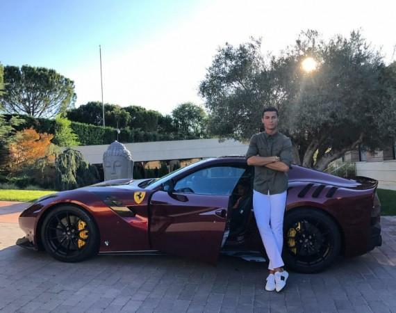 Cristiano Ronaldo with his Ferrari F12tdf