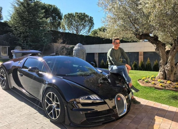Cristiano Ronaldo with his Bugatti Veyron