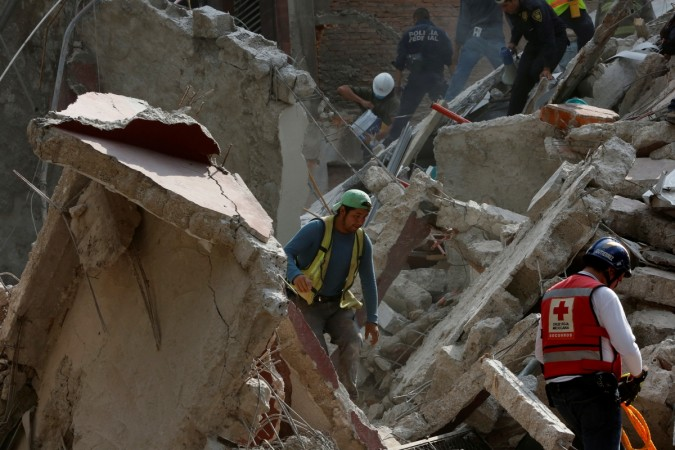 People clear rubble after an earthquake hit Mexico City
