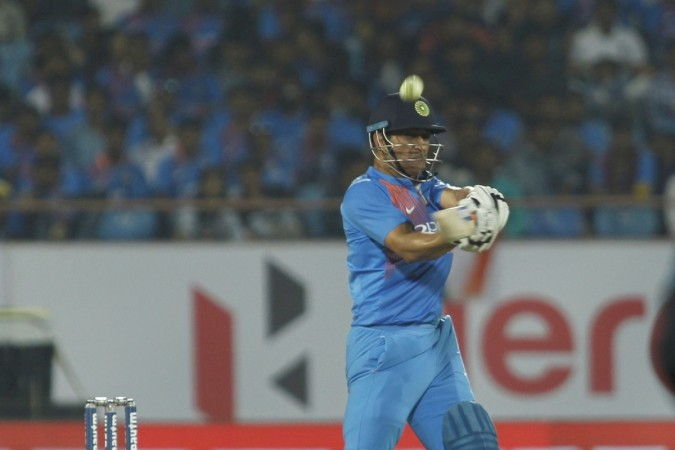 MS Dhoni plays indoor soccer volleyball during rain interruptions at Trivandrum