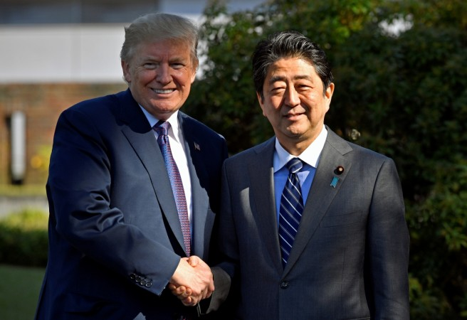 Image result for U.S. President Donald Trump shakes hands with Japan's Prime Minister Shinzo Abe at Kasumigaseki Country Club in Kawagoe