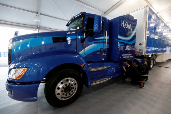 Attendees look over a prototype hydrogen powered fuel cell semi-truck shown by Toyota at the Los Angeles Auto Show 2017
