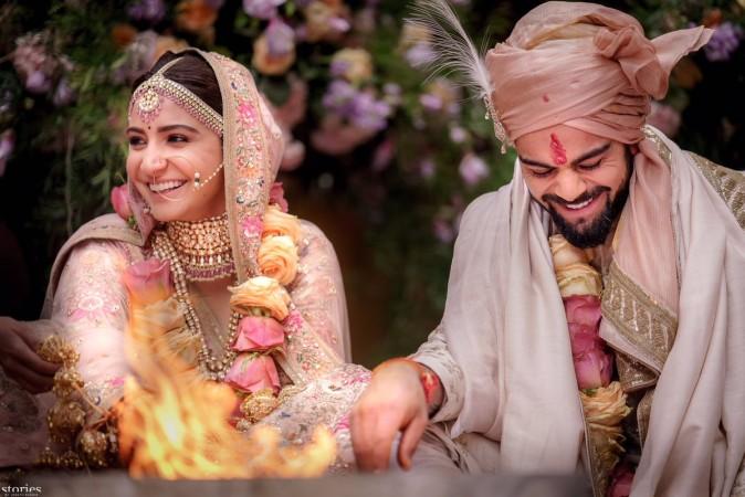 Here's the card for Anushka Sharma and Virat Kohli's grand reception