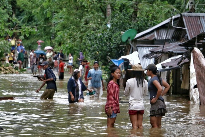 120 dead and dozens more missing after tropical storm hits Philippines