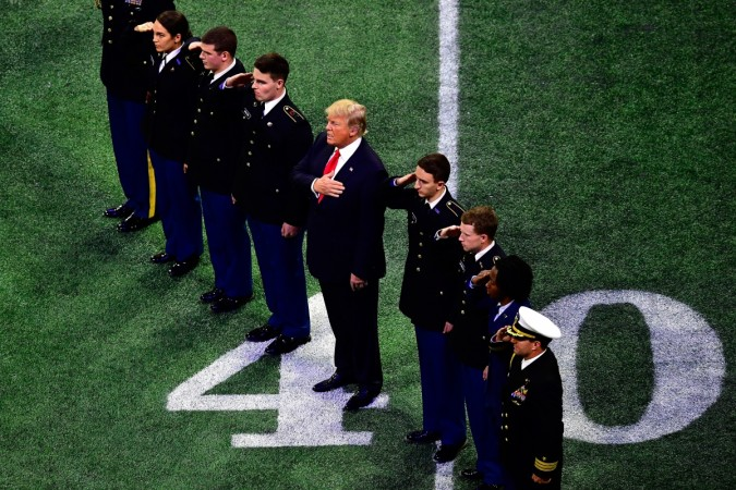 Trump skips parts of national anthem at football game