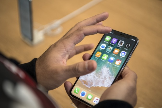 OLED panel glut looms as Apple slashes iPhone X production