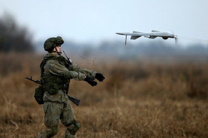 A Russian soldier launches a drone during a joint Serbian-Russian military training exercise