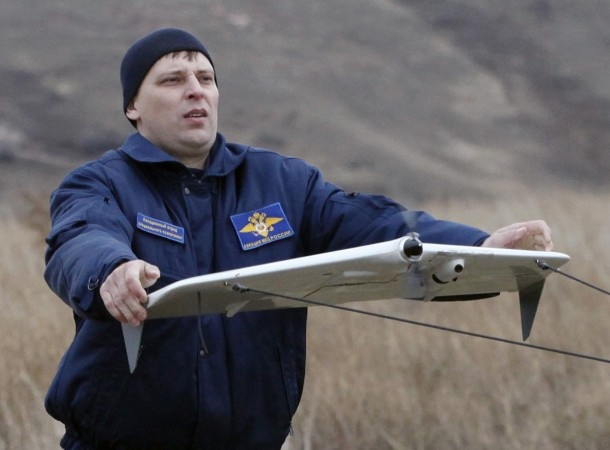 A police officer launches a Russian-made drone, an unmanned aerial vehicle (UAV),