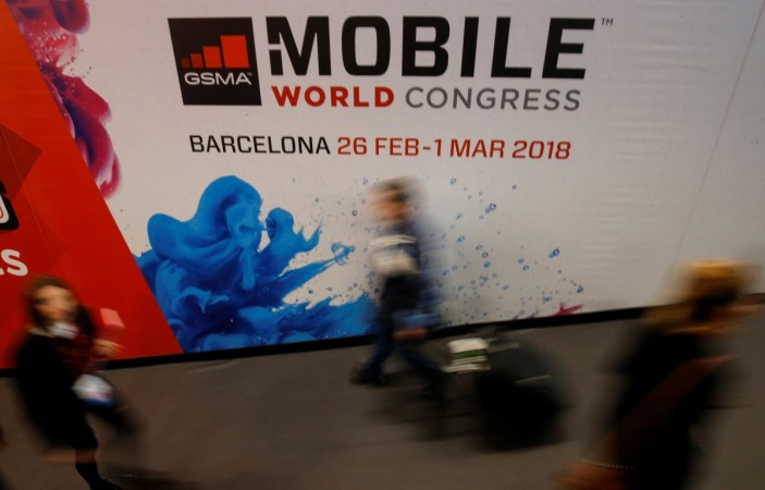 People walk past a hall at the Mobile World Congress in Barcelona, Spain