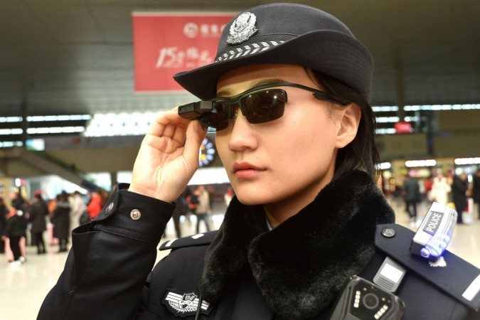 This photo taken on February 5, 2018 shows a police officer wearing a pair of smartglasses with a facial recognition system at Zhengzhou East Railway Station in Zhengzhou in China's central Henan province. Chinese police are sporting high-tech sunglasses