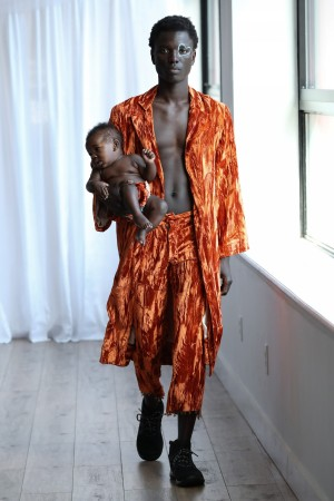 Model George Okeny walks the runway at the Collina Strada AW18 Collection with his son Zola during New York Fashion Week 2018