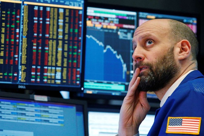 A trader reacts as he watches screens on the floor of the New York Stock Exchange in New York on Feb 5