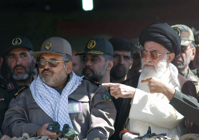 Supreme leader Ayatollah Ali Khamenei (R) and Iranian head of the military Hasan Firoz Abadi watch during the test firing of short- and medium-range missiles on 18 September 2004, amid fears in the West that Tehran is developing nuclear weapons and an ong