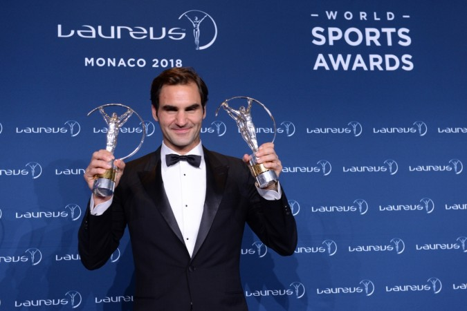 Roger Federer poses with his two Laureus Sports awards in Monaco