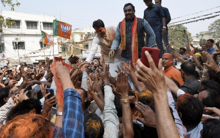 Tripura BJP president Biplab Kumar Deb along with the party's National General Secretary Ram Madhav greet party workers as they celebrate the party's performance in the recently concluded Tripura assembly elections, in Agartala on March 3, 2018.