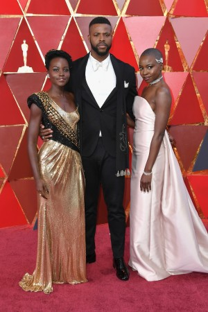 (L-R) Lupita Nyong'o, Winston Duke, and Danai Gurira attend the 90th Annual Academy Awards at Hollywood & Highland Center on March 4, 2018 in Hollywood, California.