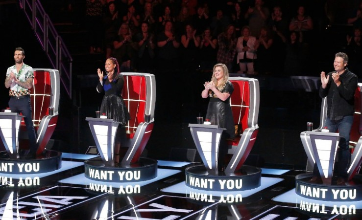 The Voice coaches (from left) Adam Levine, Alicia Keys, Kelly Clarkson and Blake Shelton giving a standing ovation to a performance