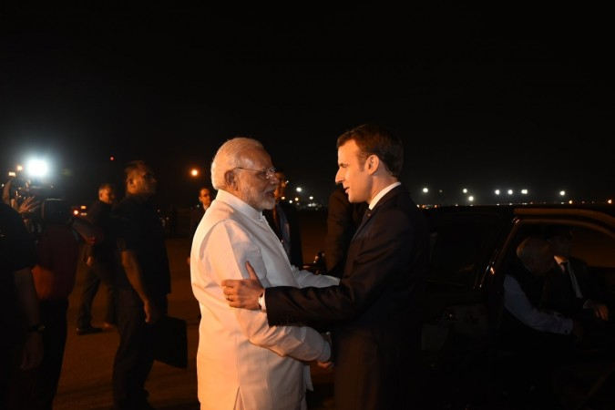 French President Emmanuel Macron was greeted by Indian Prime Minister Narendra Modi at the Delhi