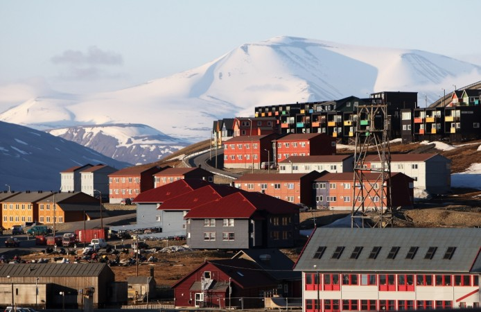 Colurful houses stand on the side of a hill on the morning of Midsummer on June 21, 2008 in Longyearbyen, Norway