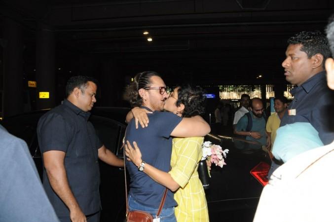 Aamir Khan kisses wife Kiran Rao at airport