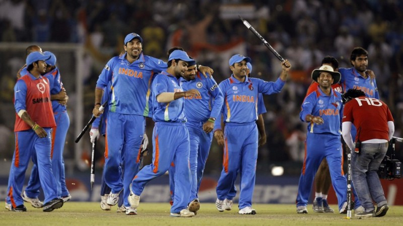 India's players celebrate after winning their ICC Cricket World Cup 2011 semi-final match against Pakistan in Mohali.