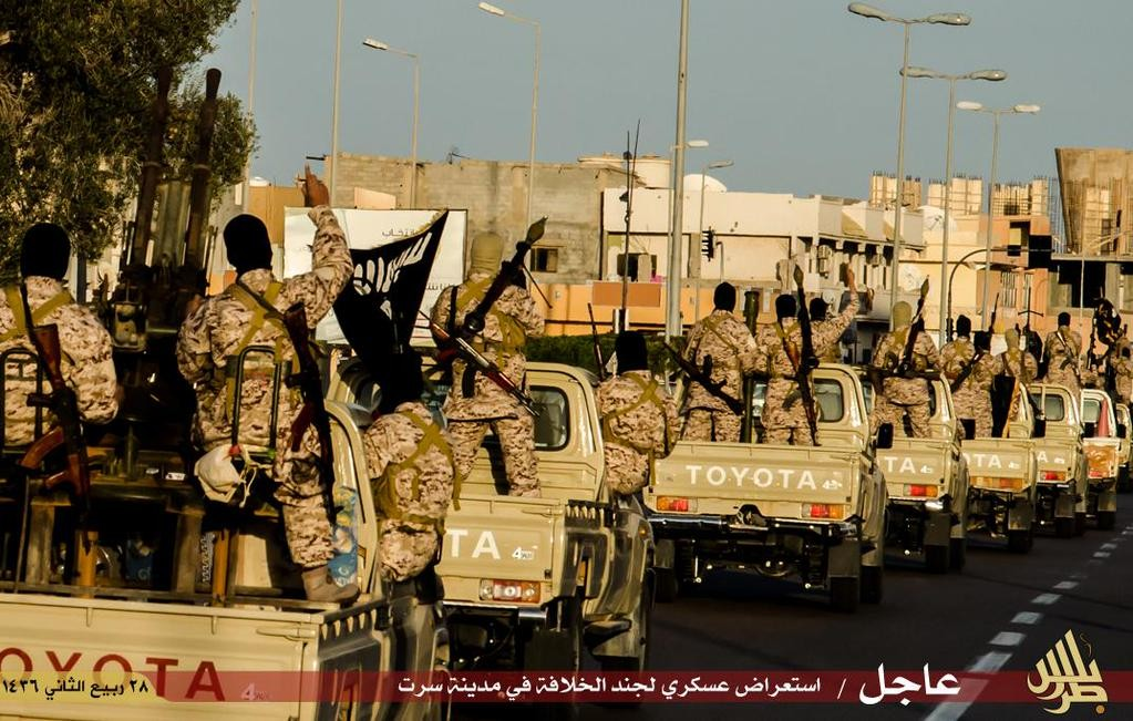 Isis Libya convoys pass through the streets of Libya as its fighters aim their guns to the sky in defiance to the air strikes by Egypt.