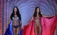 Brazilian models Adriana Lima (L) and Alessandra Ambrosio walk the runway wearing the 2 million US (1.2 million British pounds,1.6 million euros) Fantasy bras during the 2014 Victoria's Secret Fashion Show at Earl's Court exhibition centre in London on December 2, 2014.