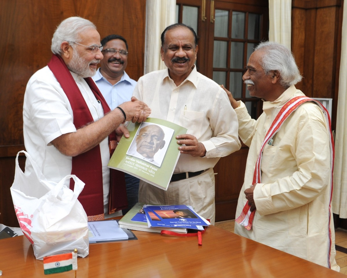 Naredra Modi releases A Saibaba Goud's transcript—Sardar Vallabhbhai Patel's biography in braille for the visually challenged—in the presence of MP Bandaru Dattatreya.