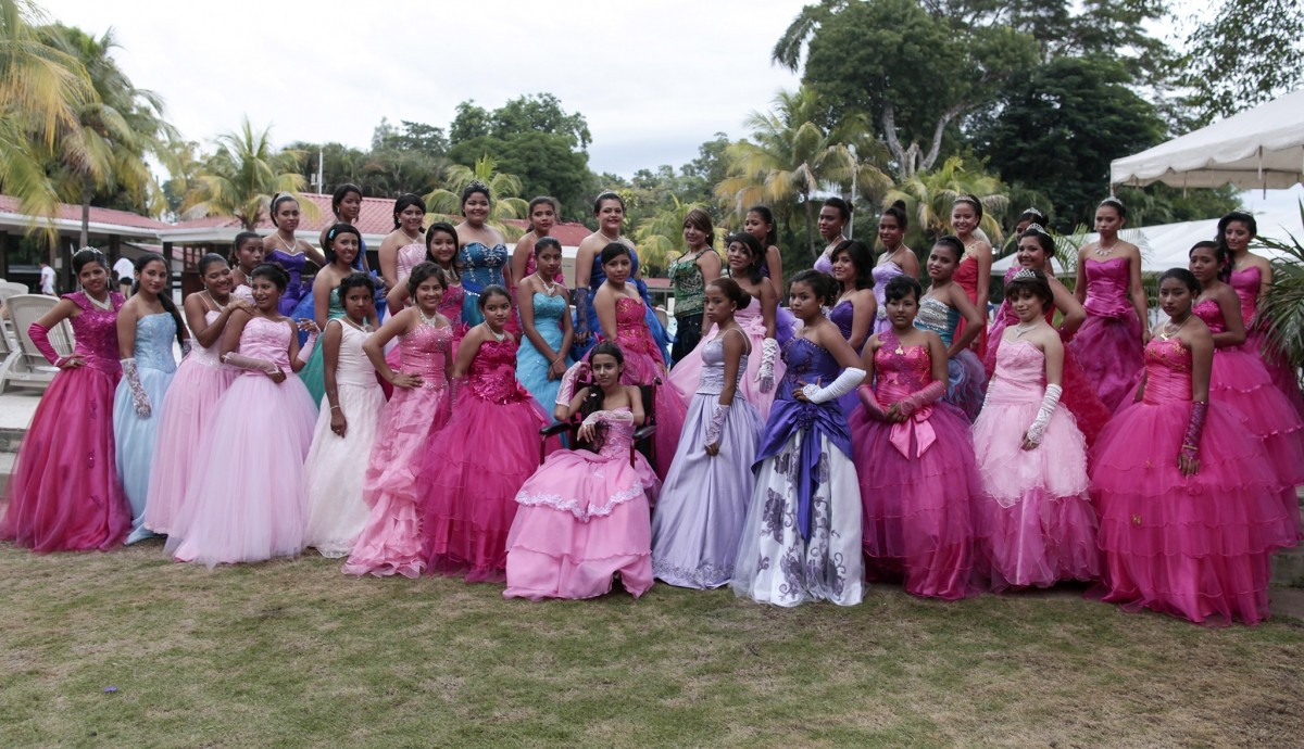 Female cancer patients pose for a group photo during their Quinceanera party at a hotel in Managua on 20 September 2014.