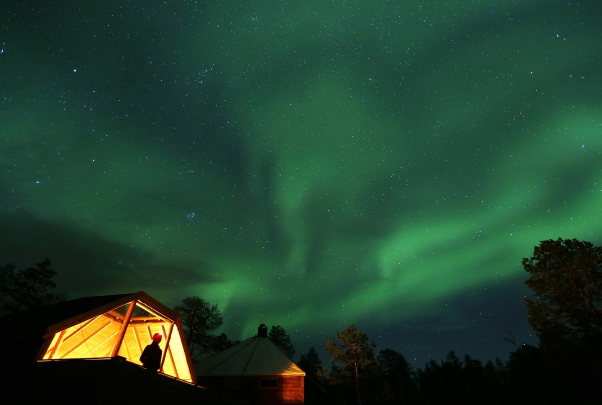 Aurora Borealis (Northern Lights) seen over a mountain camp north of the Arctic Circle