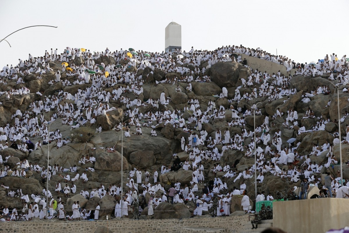 Muslim pilgrims pray on Mount Mercy on the plains of Arafat during the annual haj pilgrimage, outside the holy city of Mecca