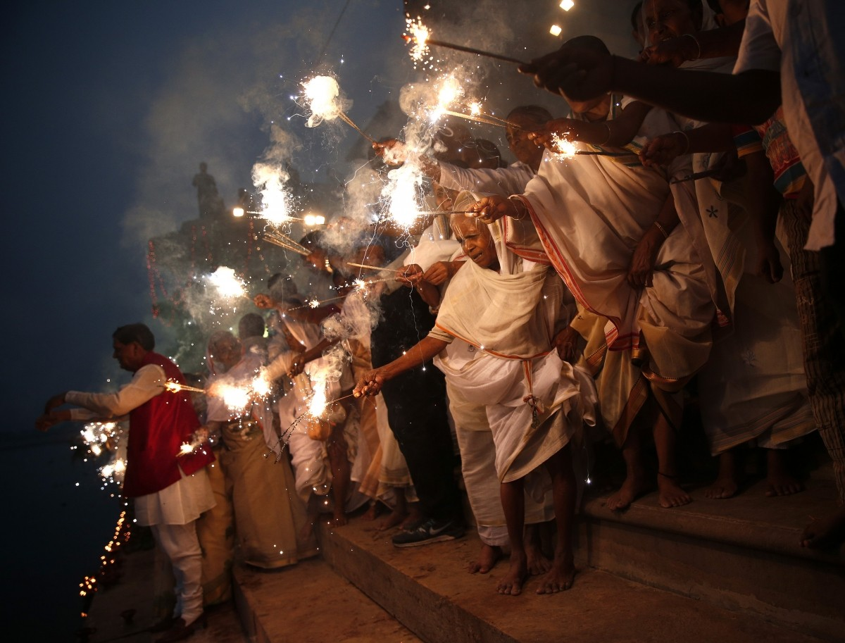 Widows, who have been abandoned by their families, light sparklers after offering prayers on the banks of the river Yamuna as part of Diwali celebrations organised by non-governmental organisation Sulabh International in Vrindavan