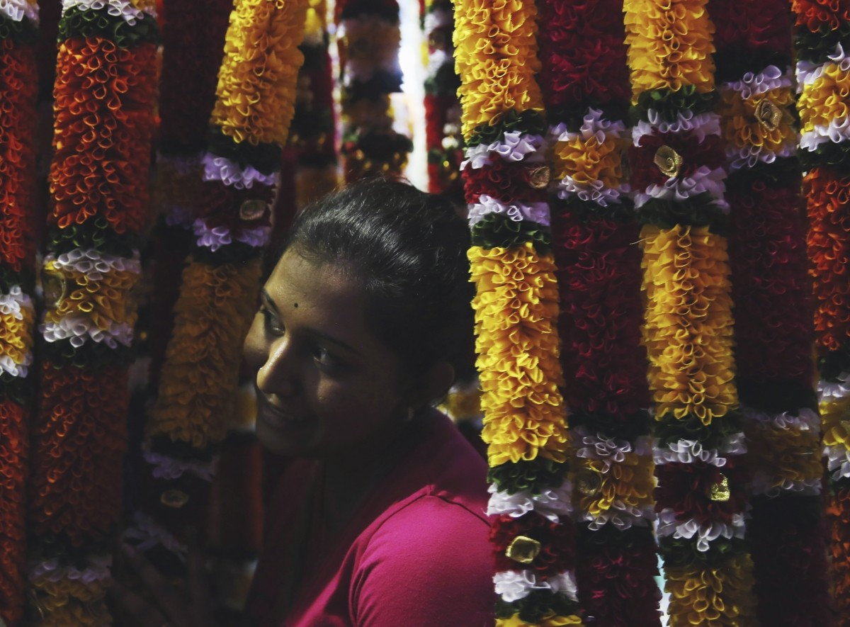 A woman shops for flower garlands ahead of Diwali celebrations in Kuala Lumpur, October 20, 2014.