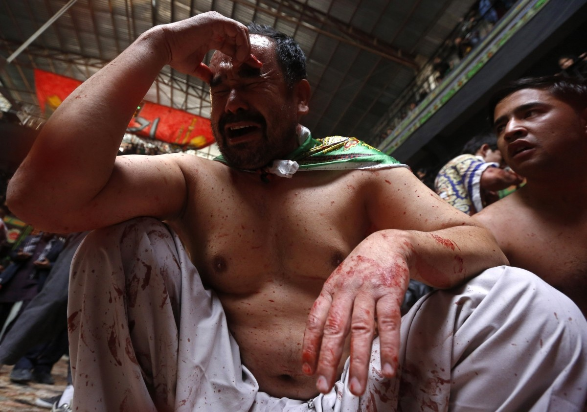 Afghan Shi'ite Muslim men flagellate themselves during a Muharram procession in Kabul October 31, 2014.
