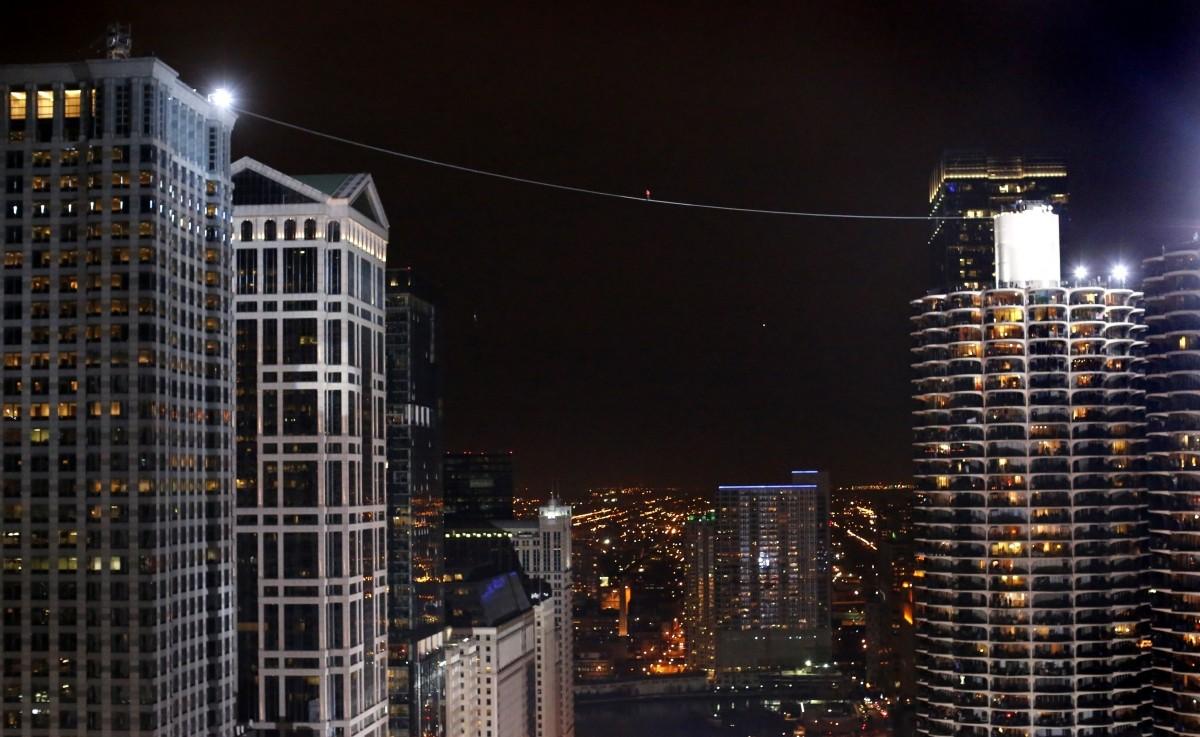 Daredevil Nik Wallenda walks along a tightrope between two skyscrapers