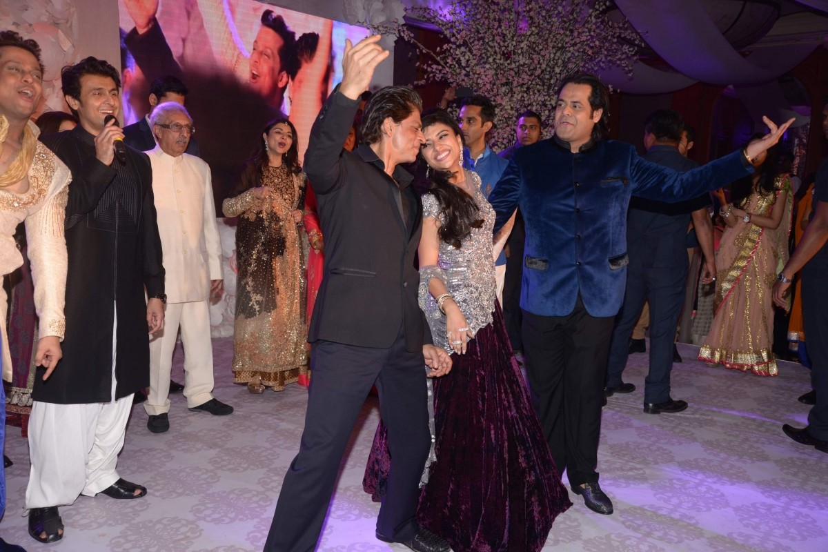 Shah Rukh dancing with Uday Singh and Shirin