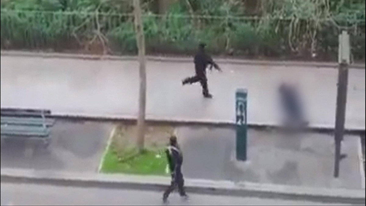 The video shows one of the two gunmen killing a wounded Paris police office outside Charlie Hebdo.