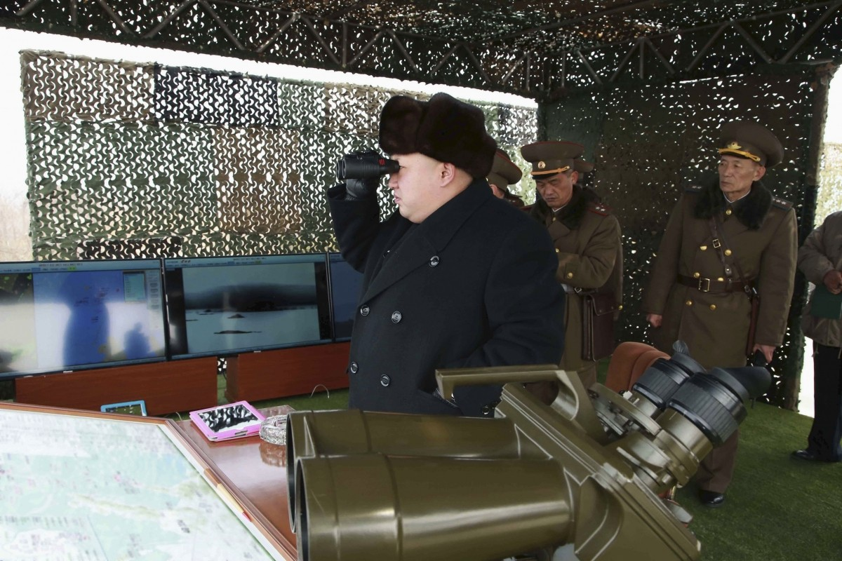 North Korean leader Kim Jong Un (C) guides artillery fire and landing exercises in this undated photo released by North Korea's Korean Central News Agency (KCNA) in Pyongyang February 21, 2015.