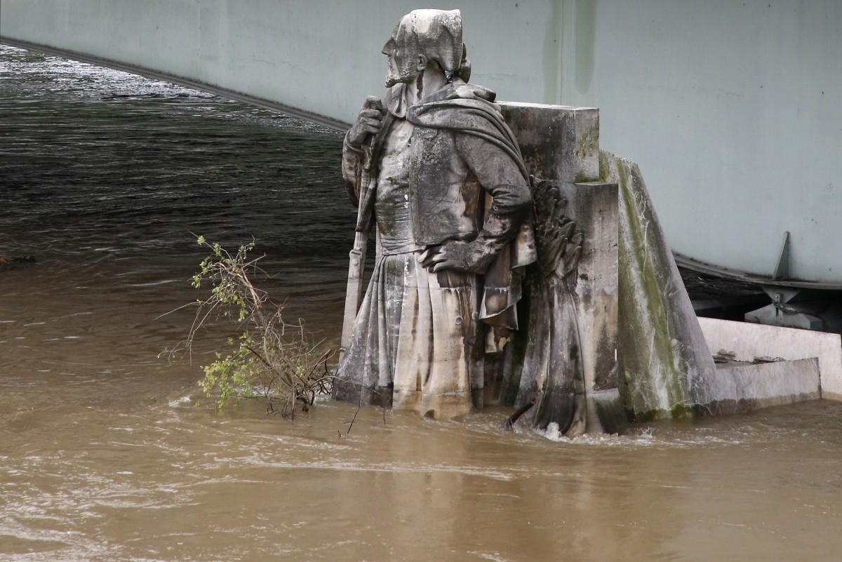 The feet of the Zouave statue on the Pont de l'Alma are covered by the rising waters from the Seine River after days of rainy weather in Paris, France, June 2, 2016 as the Zouave statue is considered an indicator of the level of the Seine, when his feet are under water, emergency flood precautions are taken.