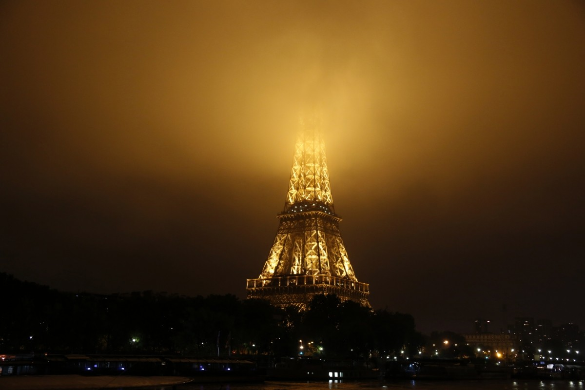 Fog covers the top of the Eiffel Tower as rainy weather continues in Paris, France, June 2, 2016.